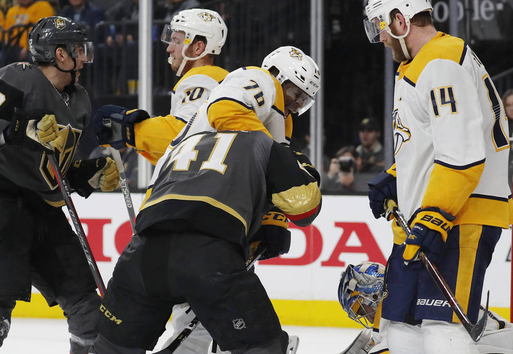 Nashville Predators defenseman P.K. Subban (76) holds on to Vegas Golden Knights center Pierre-Edouard Bellemare (41) after a play during the second period of an NHL hockey game Wednesday, Jan. 23 ...