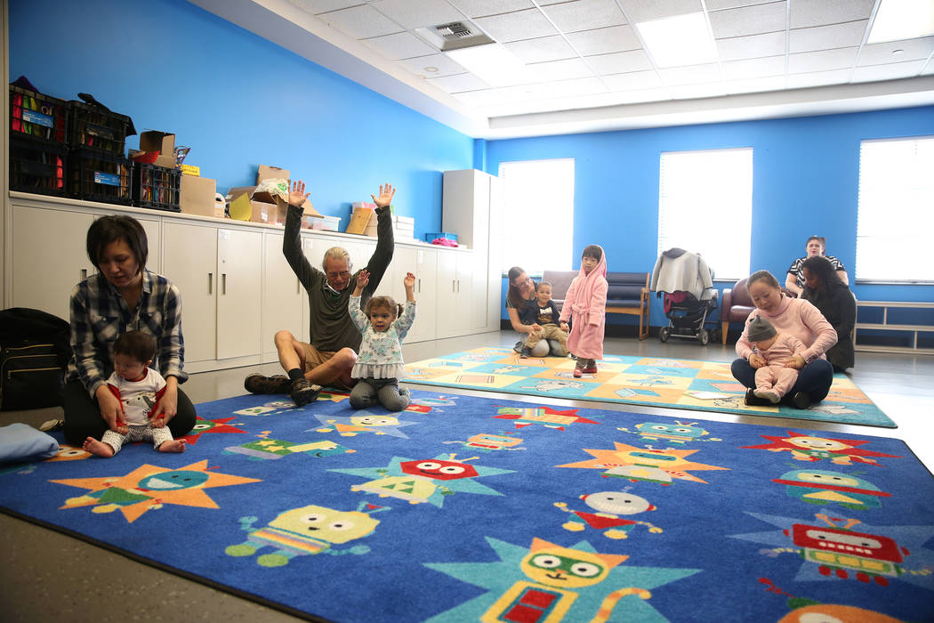 """People participate during a dance and activity class, """"Tiny Toes on the Go,""""at the Clark County Library in Las Vegas, Friday, Feb. 15, 2019. (Erik Verduzco/Las Vegas Review-Journal) @Eri ..."""