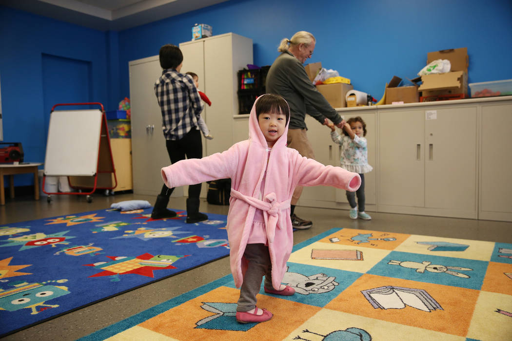 """Emy Ma, 3, of Las Vegas, participates during a dance and activity class, """"Tiny Toes on the Go,""""at the Clark County Library in Las Vegas, Friday, Feb. 15, 2019. (Erik Verduzco/Las Vegas R ..."""