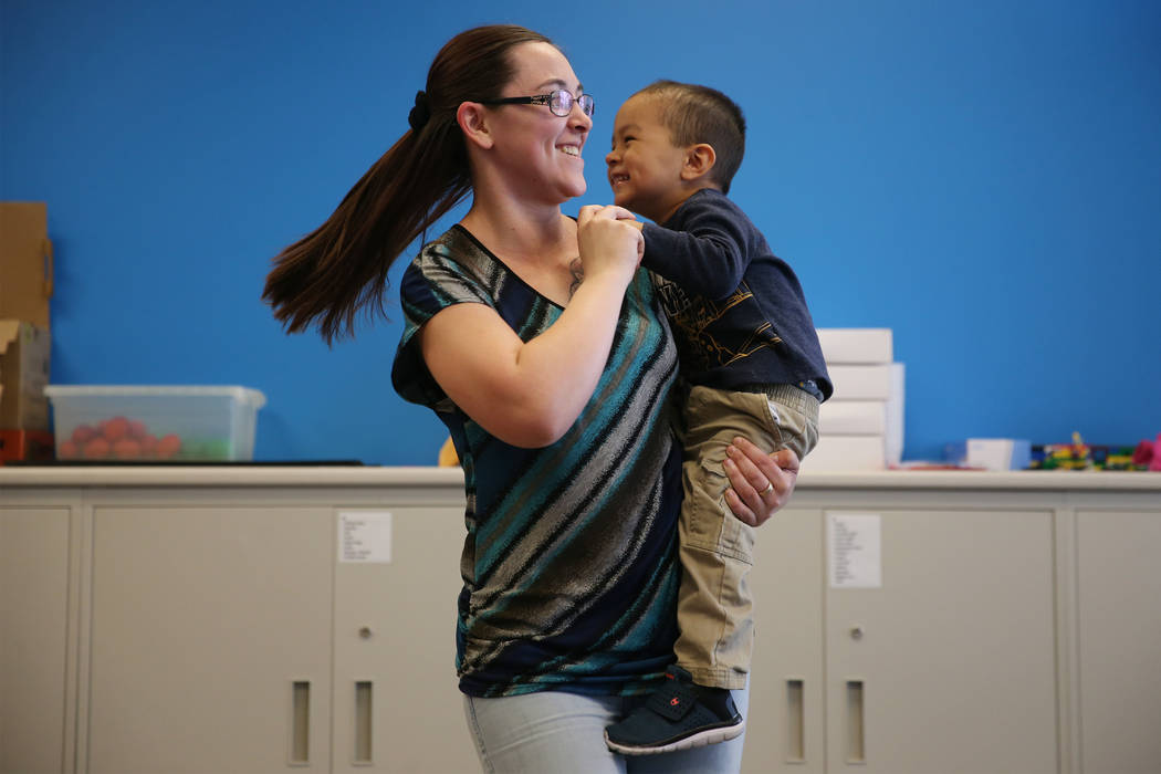 """Victoria Karvonen and her son Angelo, 2, of Las Vegas, participate during a dance and activity class, """"Tiny Toes on the Go,""""at the Clark County Library in Las Vegas, Friday, Feb. 15, 201 ..."""