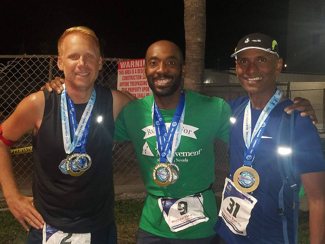 Left to right: Matt Buck, of the United States, Michael Crome, of the United States and Eravanan Rao, of Australia, finish the race in Miami of Feb 7. (World Marathon Challenge)