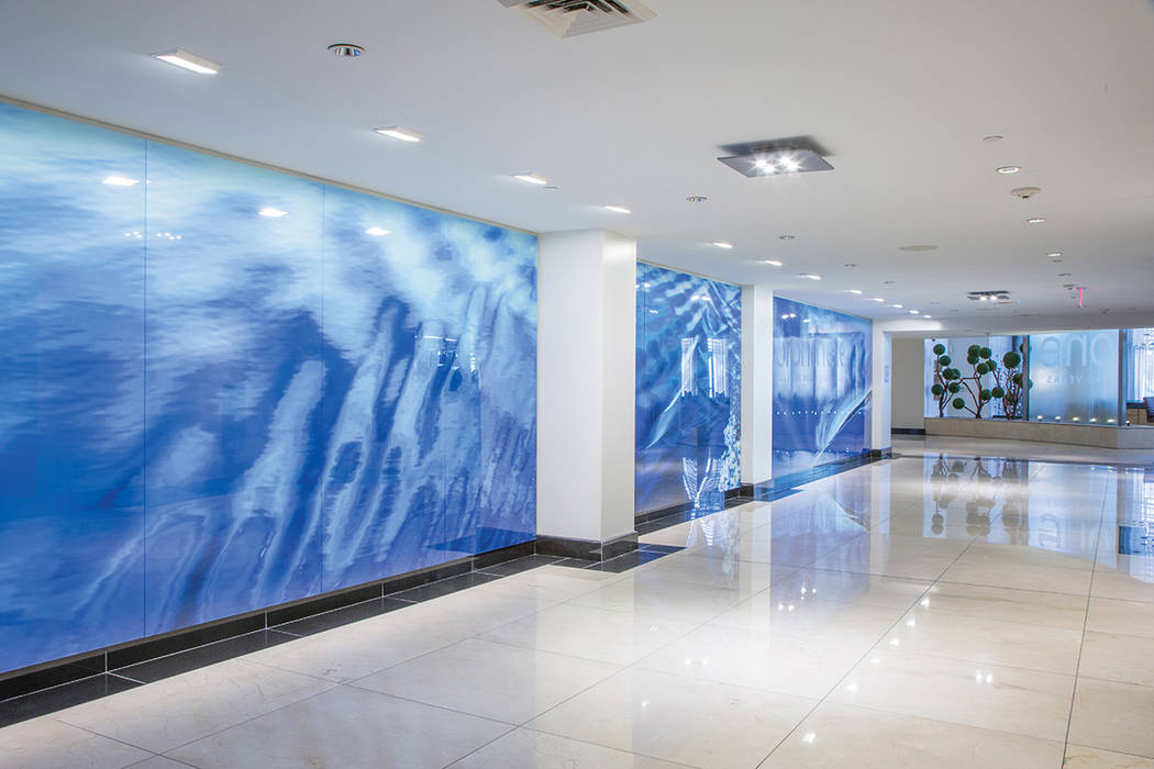 """""""Waterway,"""" a 54-foot custom photographic installation by acclaimed artist and photographer, Marilyn Suriani, graces the lobby of One Las Vegas. (One Las Vegas)"""