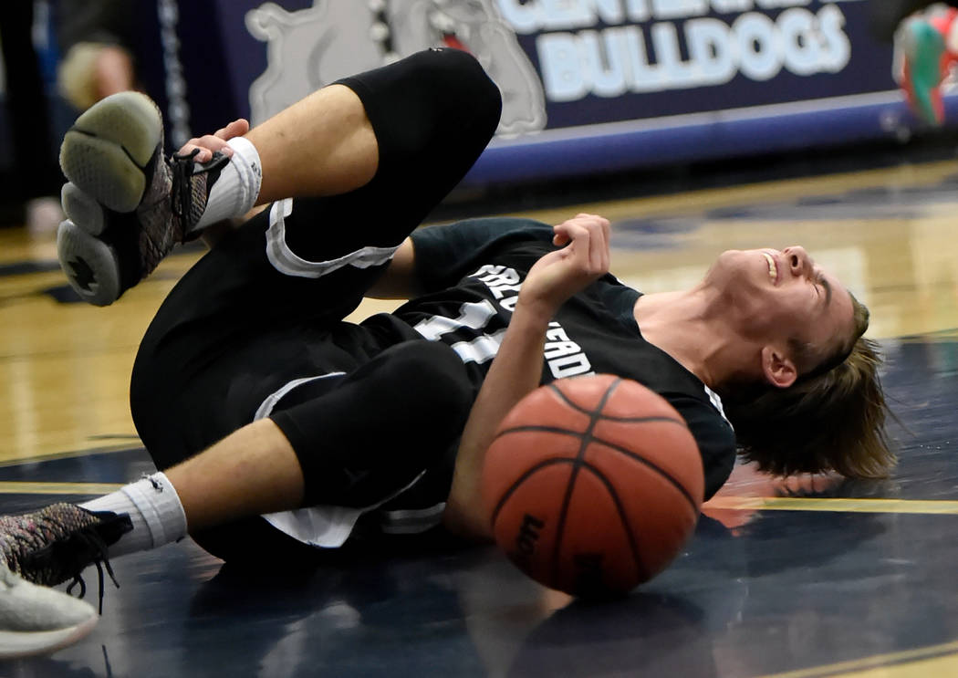 Palo Verde's Caden Loerwald reacts after a taking a bad fall against Centennial during a high school basketball game at Centennial High School Friday, Feb. 15, 2019, in Las Vegas. (David Becker/La ...