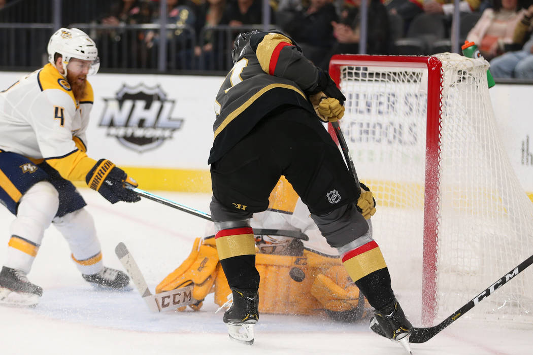 Vegas Golden Knights left wing Max Pacioretty (67) works to make a shot before scoring against Nashville Predators during the first period of an NHL hockey game at T-Mobile Arena in Las Vegas, Sat ...
