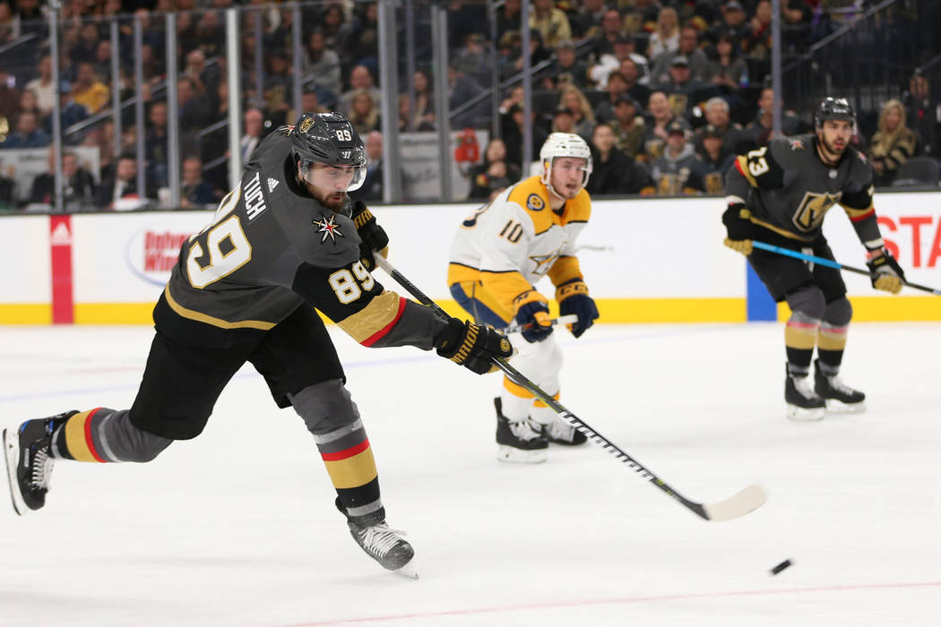 Vegas Golden Knights right wing Alex Tuch (89) takes a shot against Nashville Predators during the first period of an NHL hockey game at T-Mobile Arena in Las Vegas, Saturday, Feb. 16, 2019. (Erik ...