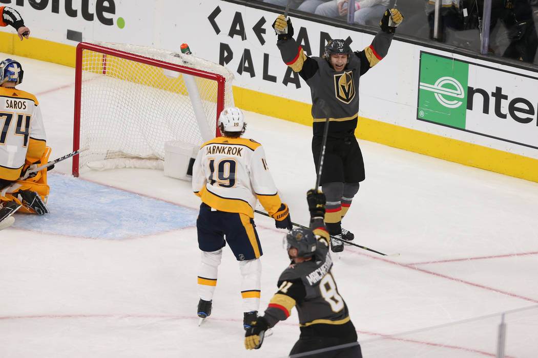 Vegas Golden Knights center William Karlsson (71) raises his arms in celebration of a score by center Brandon Pirri (73) during the second period of an NHL hockey game at T-Mobile Arena in Las Veg ...