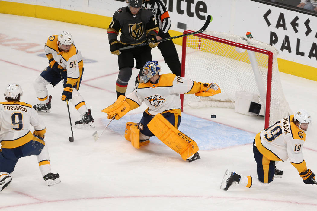 A shot by Vegas Golden Knights center Brandon Pirri (73) goes past Nashville Predators goaltender Juuse Saros (74) for a score during the second period of an NHL hockey game at T-Mobile Arena in L ...