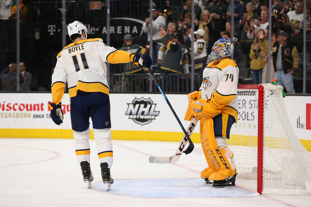 Nashville Predators center Brian Boyle (11) taps goaltender Juuse Saros (74) with his stick after allowing a score against the Vegas Golden Knights during the third period of an NHL hockey game at ...