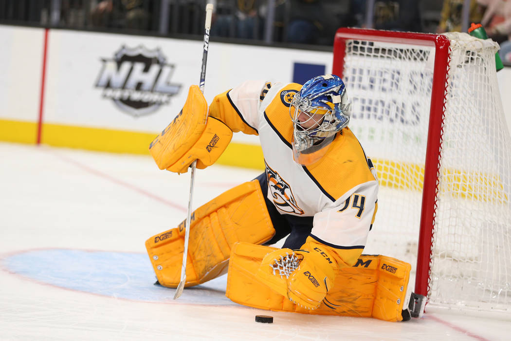 Nashville Predators goaltender Juuse Saros (74) makes a stop against the Vegas Golden Knights during the third period of an NHL hockey game at T-Mobile Arena in Las Vegas, Saturday, Feb. 16, 2019. ...