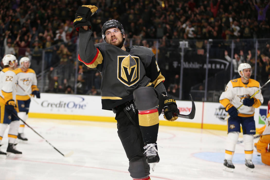 Vegas Golden Knights defenseman Shea Theodore (27) celebrates his score during the third period of an NHL hockey game at T-Mobile Arena in Las Vegas, Saturday, Feb. 16, 2019. (Erik Verduzco/Las Ve ...