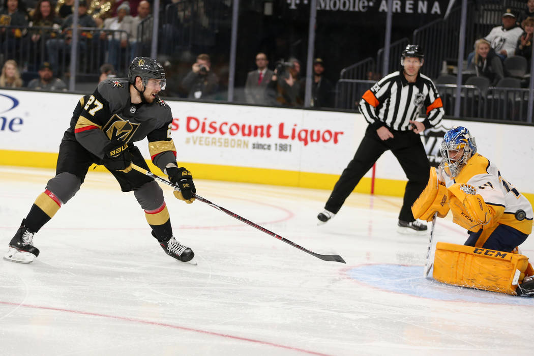 Vegas Golden Knights defenseman Shea Theodore (27) shoot for a score against Nashville Predators goaltender Juuse Saros (74) during the third period of an NHL hockey game at T-Mobile Arena in Las ...
