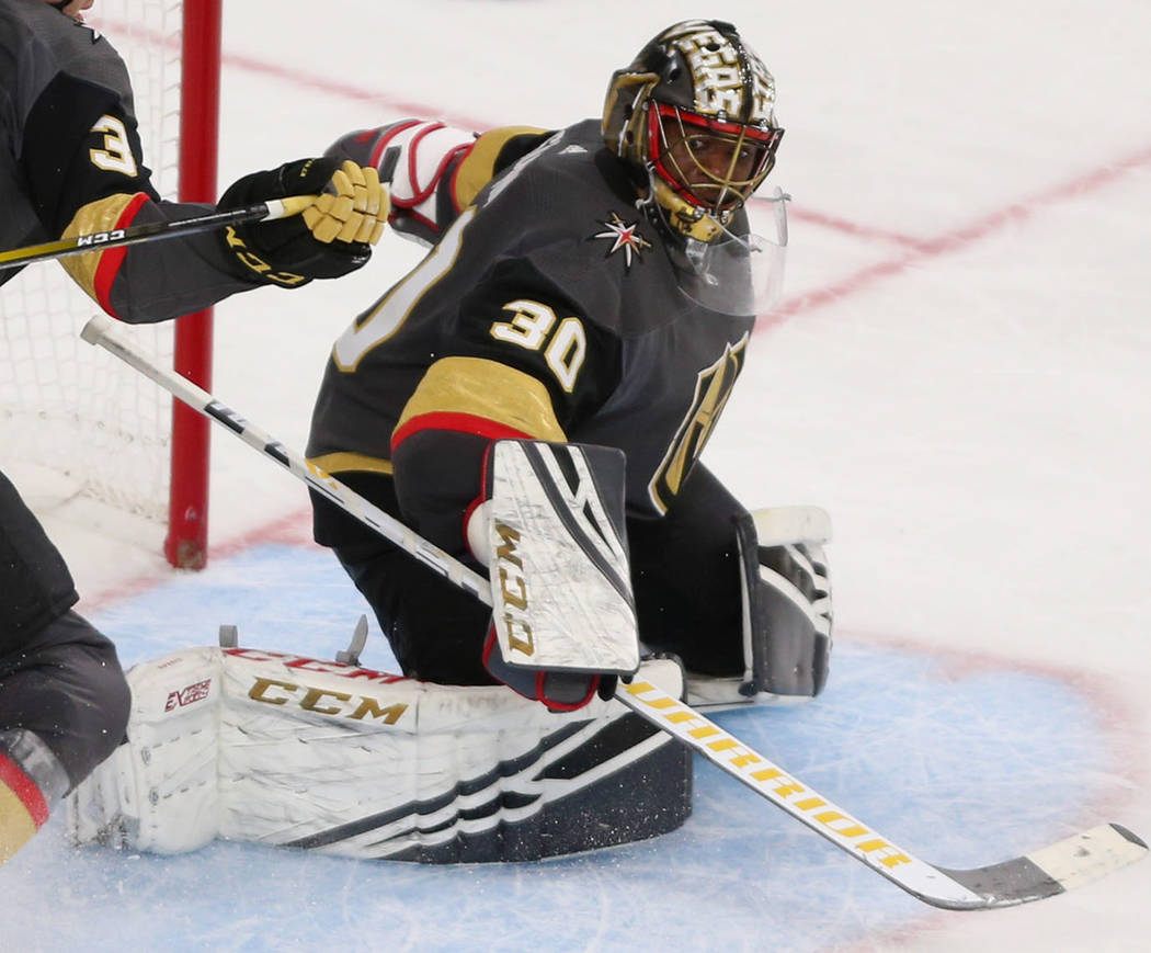 Vegas Golden Knights goaltender Malcolm Subban (30) makes a stop against the Nashville Predators during the second period of an NHL hockey game at T-Mobile Arena in Las Vegas, Saturday, Feb. 16, 2 ...