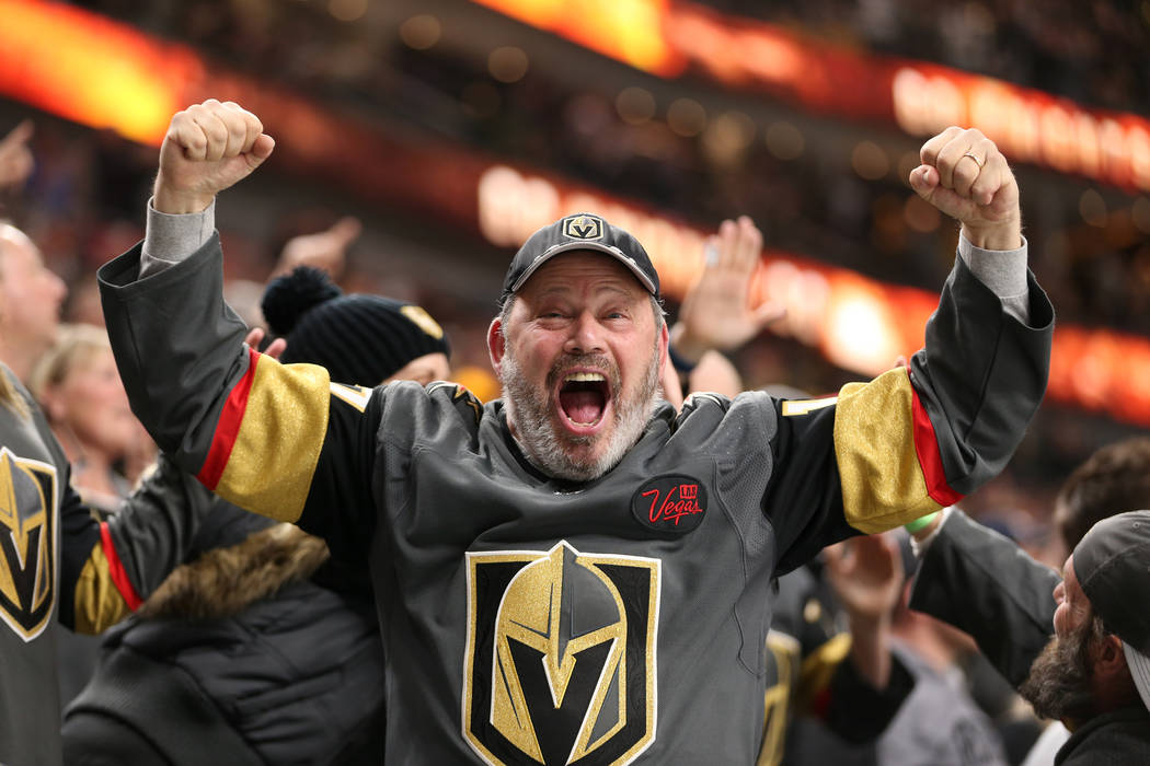 A fan celebrates a score by Vegas Golden Knights left wing Max Pacioretty (67) against Nashville Predators during the first period of an NHL hockey game at T-Mobile Arena in Las Vegas, Saturday, F ...