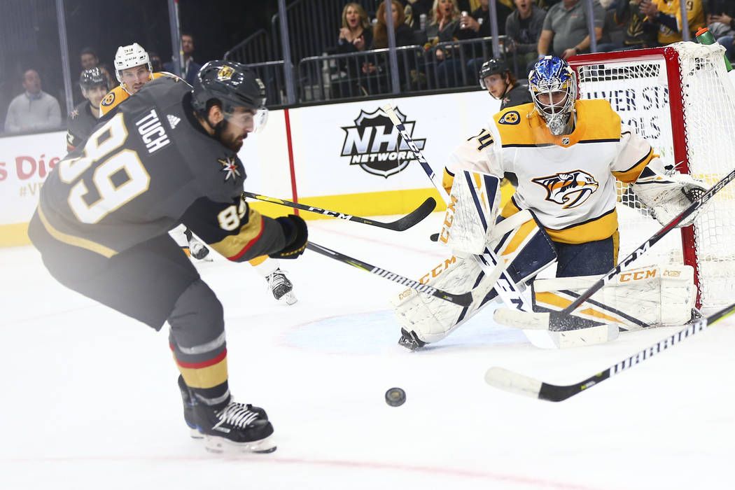 Golden Knights right wing Alex Tuch (89) looks to shoot against Nashville Predators goaltender Juuse Saros (74) during the first period of an NHL hockey game at T-Mobile Arena in Las Vegas on Wedn ...