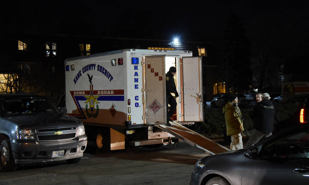 Investigators work at the apartment complex of the alleged shooter from the Henry Pratt Co. on Friday, Feb. 15, 2019, in Aurora, Ill. An employee of a manufacturing company opened fire in its subu ...