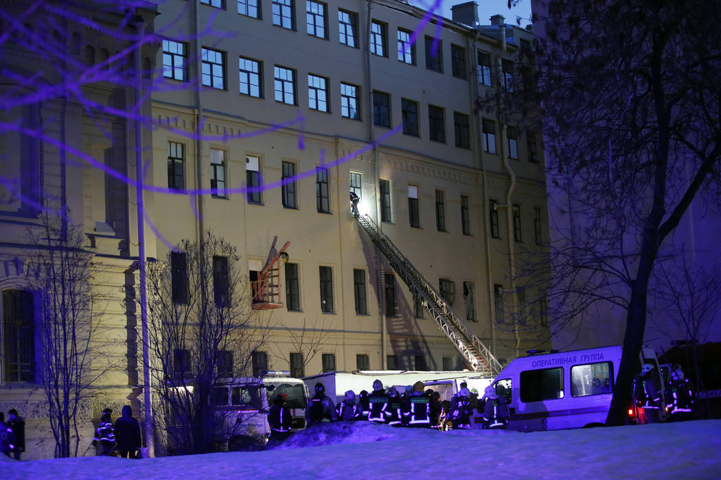Russian Emergency employees work at the scene of the collapse building of the Saint Petersburg National Research University of Information Technologies, Mechanics and Optics in St. Petersburg, Rus ...