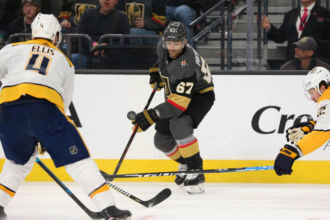 Vegas Golden Knights left wing Max Pacioretty (67) works to control the puck against Nashville Predators center Ryan Johansen (92) during the first period of an NHL hockey game at T-Mobile Arena i ...