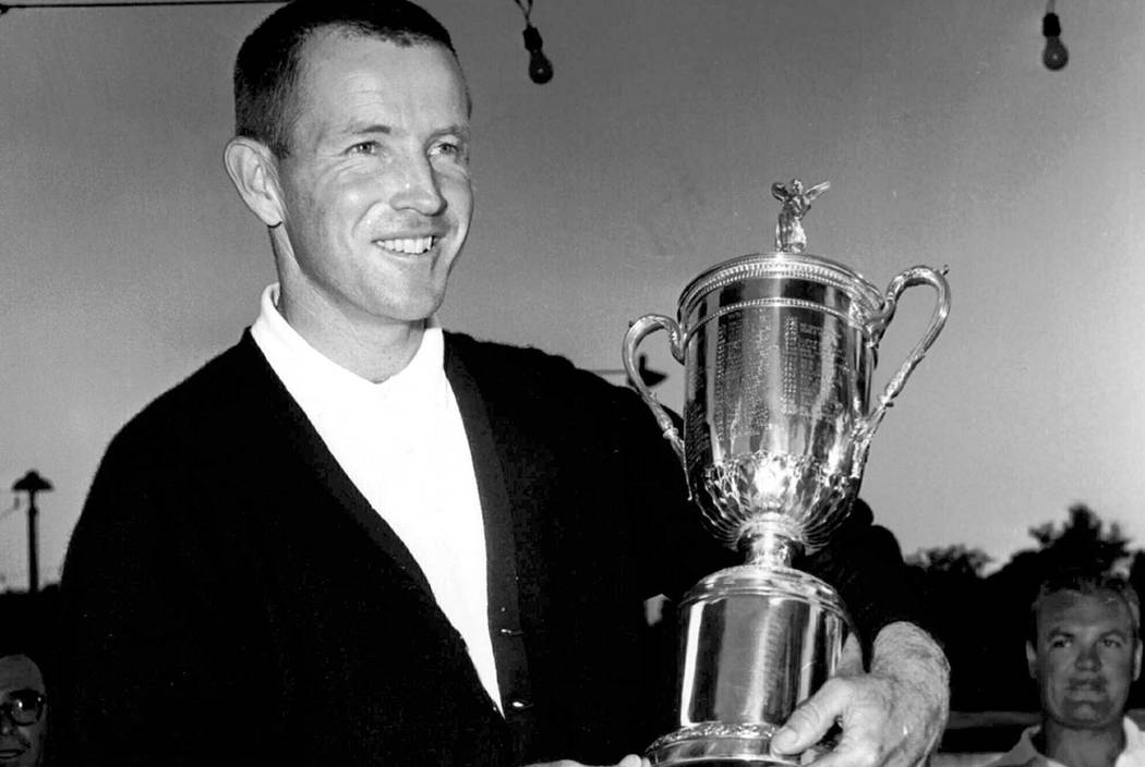In this June 17, 1961, photo, Gene Littler holds the trophy after winning the U.S. Open golf tournament in Birmingham, Mich. (AP Photo/File)