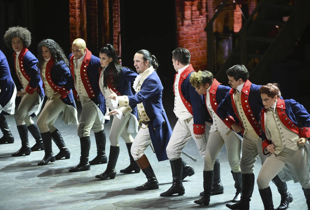 "Lin-Manuel Miranda, center, and the cast of ""Hamilton"" perform at the Tony Awards in New York. (Photo by Evan Agostini/Invision/AP)"