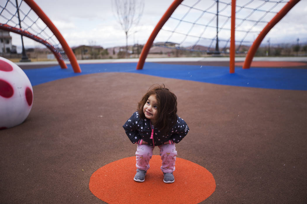 Madison Luisi, 2, plays in the hail at Fox Hill Park in Las Vegas, Sunday, Feb. 17, 2019. (Rachel Aston/Las Vegas Review-Journal) @rookie__rae