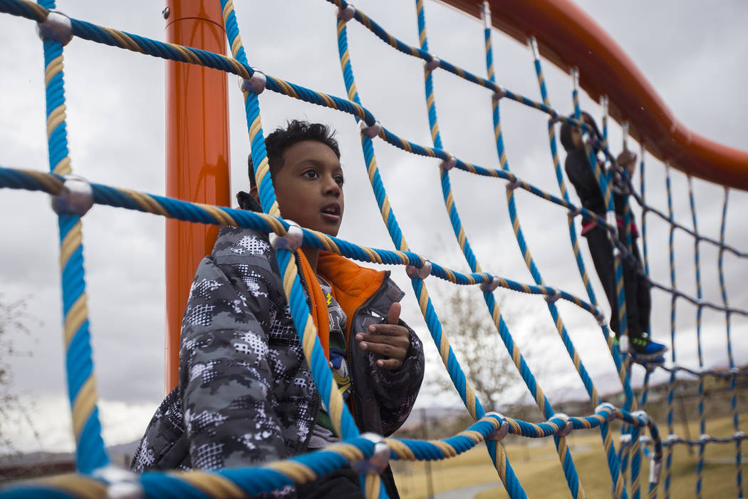 Nyko Minnifield, 7, left, and his brother Bryson Minniefield, 4, climb a structure in the hail at Fox Hill Park in Las Vegas, Sunday, Feb. 17, 2019. (Rachel Aston/Las Vegas Review-Journal) @rookie ...