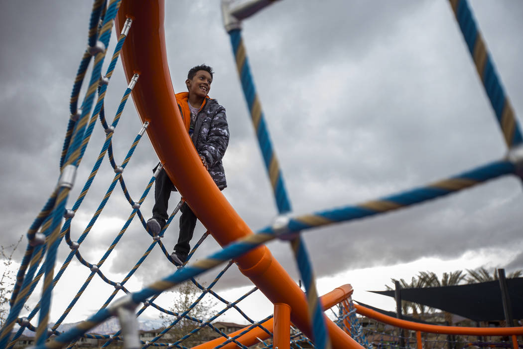 Nyko Minnifield, 7, climbs a structure in the hail at Fox Hill Park in Las Vegas, Sunday, Feb. 17, 2019. (Rachel Aston/Las Vegas Review-Journal) @rookie__rae