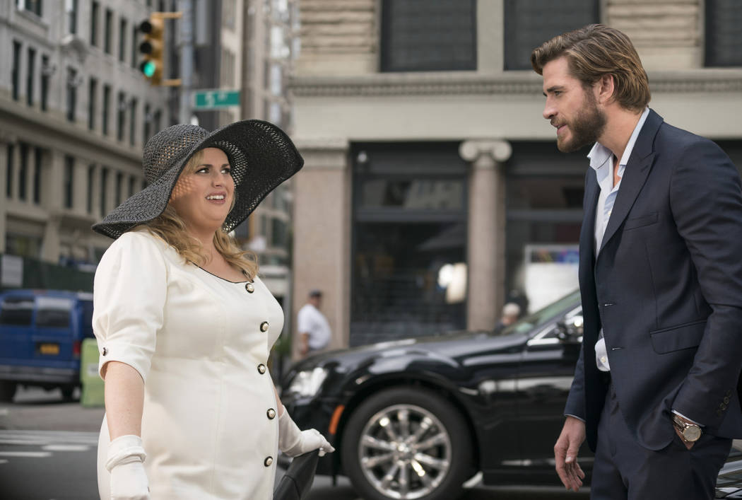 "This image released by Warner Bros. Pictures shows Rebel Wilson, left, and Liam Hemsworth in a scene from the film, ""Isn't It Romantic."" (Michael Parmelee/Warner Bros. Pictures via AP)"