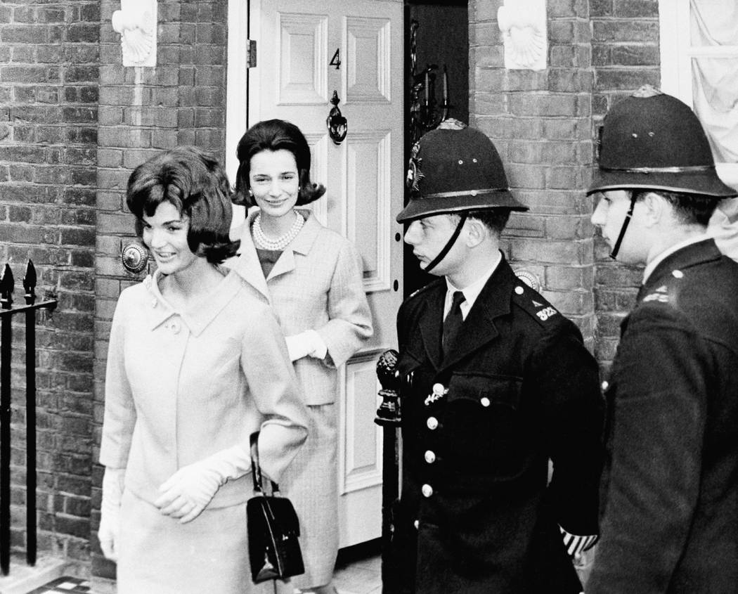 FILE - In this June 6, 1961 file photo, Jacqueline Kennedy is followed by her sister, Lee Radziwill, in London. Radziwill, the stylish jet setter and socialite who made friends worldwide even as ...