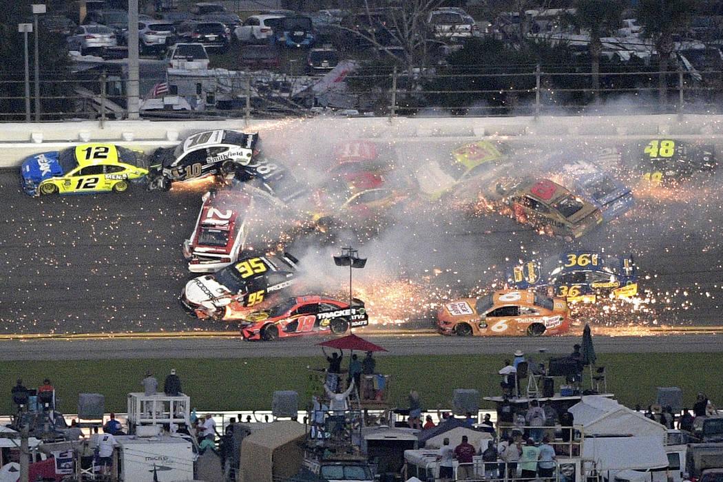Ryan Blaney (12), Aric Almirola (10), Paul Menard (21), David Ragan (38) and Matt DiBenedetto (95) start a multi-car wreck between Turns 3 and 4 during the NASCAR Daytona 500 auto race at Daytona ...
