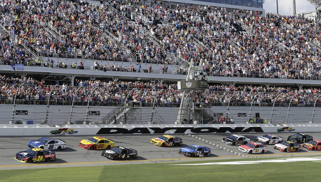 William Byron (24) and Alex Bowman (88) lead the field to start a NASCAR Daytona 500 auto race at Daytona International Speedway, Sunday, Feb. 17, 2019, in Daytona Beach, Fla. (AP Photo/Terry Renna)