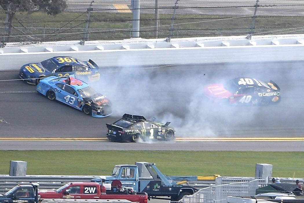 Matt Tifft (36), Darrell Wallace Jr. (43), Kurt Busch (1) and Jamie McMurray (40) are involved in a wreck in Turn 2 during a NASCAR Daytona 500 auto race at Daytona International Speedway, Sunday, ...