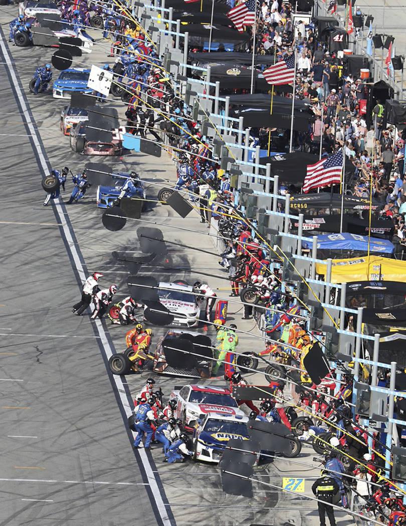 Car pull in the pits for tires and fuel during a NASCAR Daytona 500 auto race at Daytona International Speedway, Sunday, Feb. 17, 2019, in Daytona Beach, Fla. (AP Photo/David Graham)