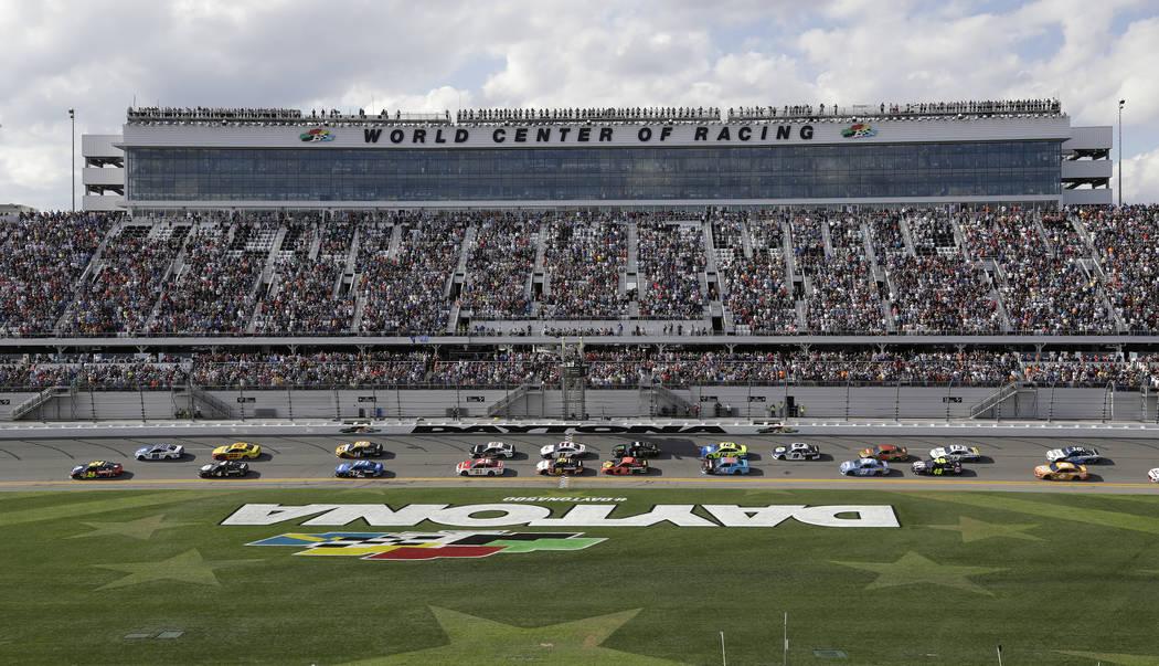 William Byron (24) and Alex Bowman (88) lead the field at the start of a NASCAR Daytona 500 auto race Sunday, Feb. 17, 2019, at Daytona International Speedway in Daytona Beach, Fla. (AP Photo/Chri ...