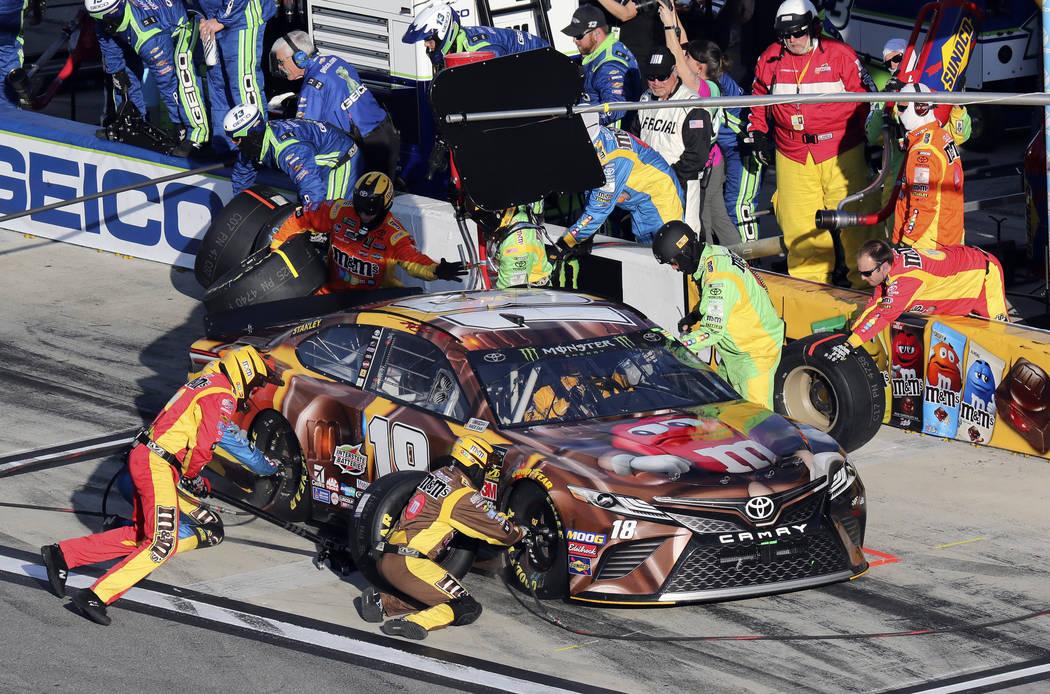 Kyle Busch makes a pit stop during the NASCAR Daytona 500 auto race at Daytona International Speedway, Sunday, Feb. 17, 2019, in Daytona Beach, Fla. (AP Photo/David Graham)
