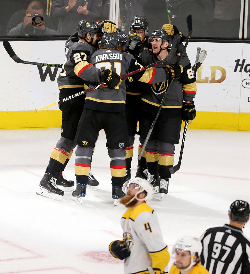 The Vegas Golden Knights celebrate a score by center Brandon Pirri (73) during the second period of an NHL hockey game at T-Mobile Arena in Las Vegas, Saturday, Feb. 16, 2019. (Erik Verduzco/Las V ...