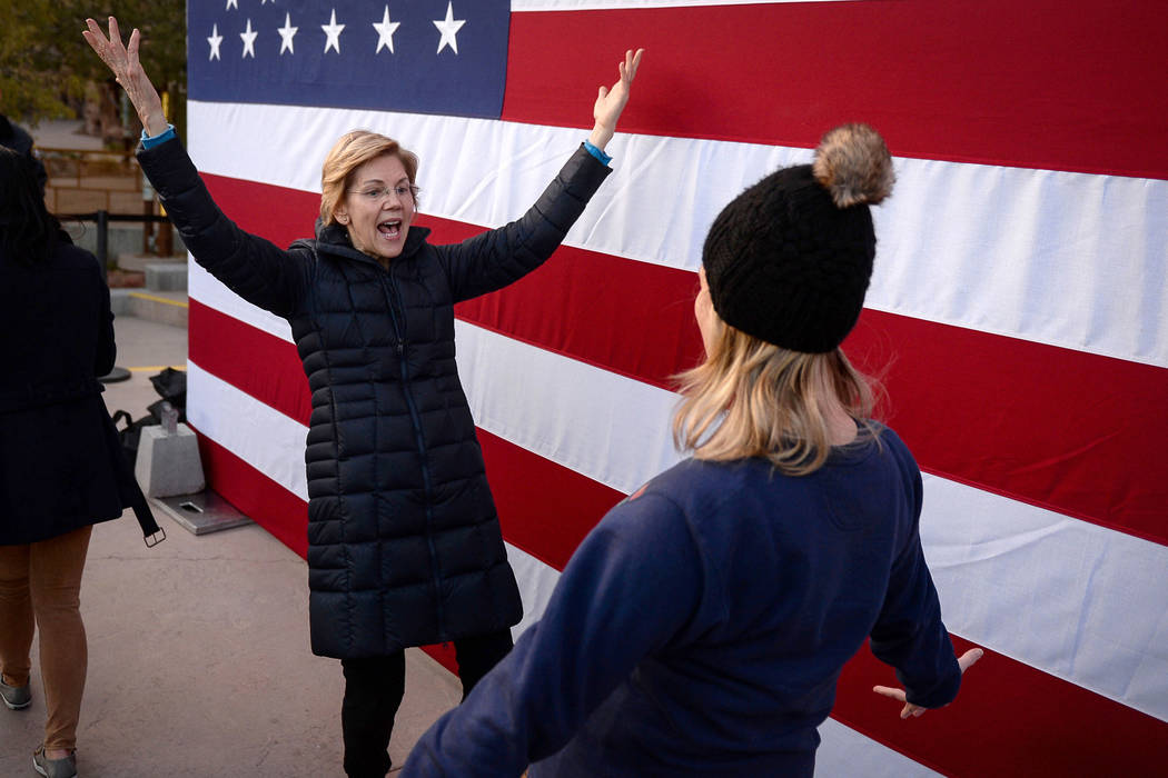 Elizabeth Warren greats a supporter after delivering a speech about her platform for running for the President of the United States in 2020 at Springs Preserve in Las Vegas, Sunday, Feb. 17, 2019. ...