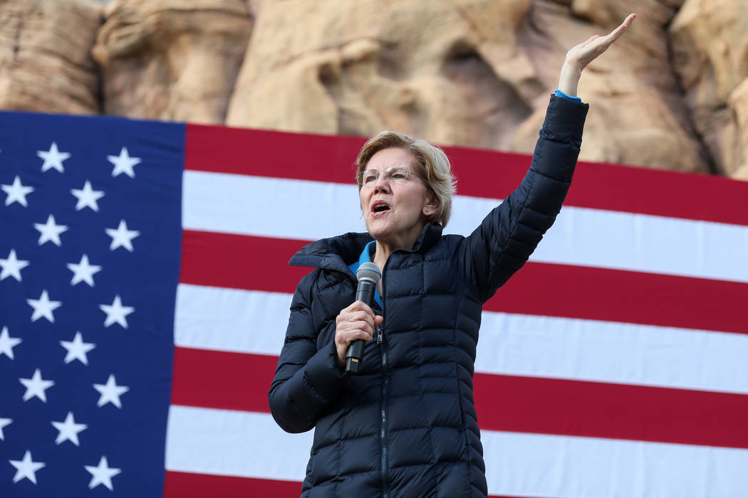 Elizabeth Warren greats a crowd of people before delivering a speech about her platform to run for President of the United States in 2020 at Springs Preserve in Las Vegas, Sunday, Feb. 17, 2019. ( ...