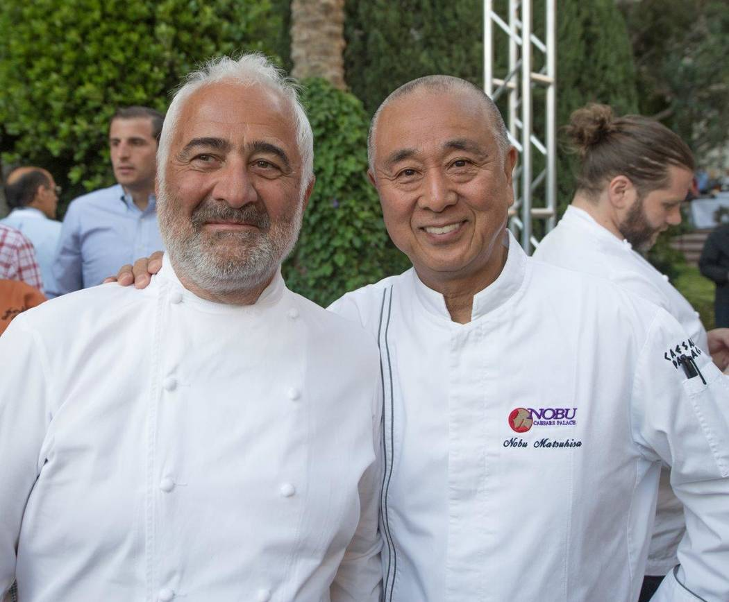Guy Savoy and Nobu Matsuhisa attend The Grand Tasting at Vegas Uncork'd by Bon Appetit at Garden of the Gods Pool Oasis at Caesars Palace on Friday, April 28, 2017, in Las Vegas. (Tom Donoghue)
