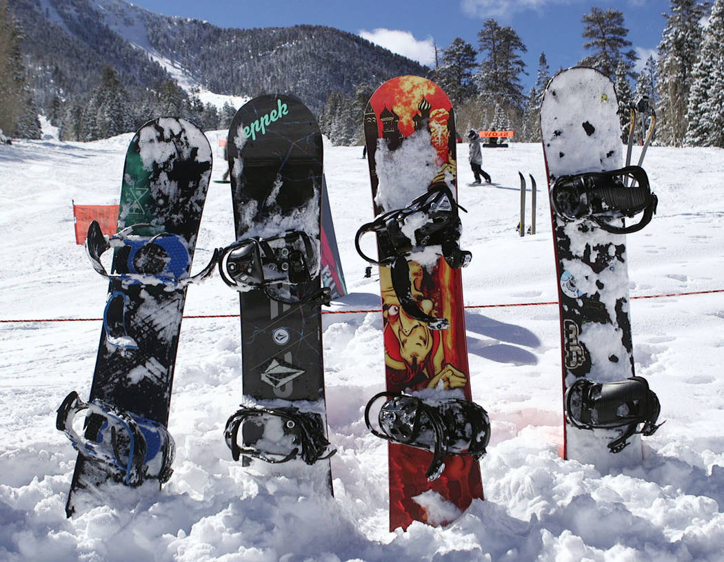 Snowboards stick up from the snow at Lee Canyon outside Las Vegas on Monday, Feb. 18, 2019. Mount Charleston received nearly four inches of snow on Sunday according to the National Weather Service ...