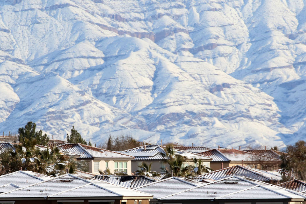 Snow covered roofs and mountain are seen in Summerlin on Monday, Feb. 18, 2019. (Bizuayehu Tesfaye/Las Vegas Review-Journal) @bizutesfaye