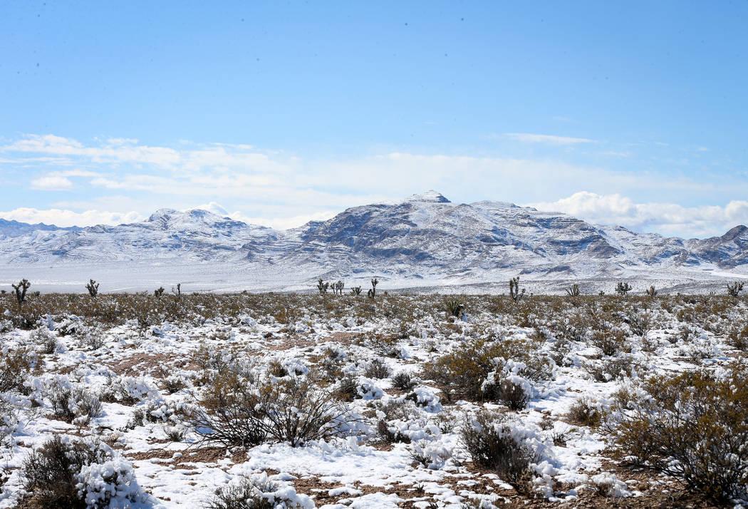 Snow covers the surrounding mountains near the Seven Magic Mountains in Clark County, Monday, Feb. 18, 2019. (Caroline Brehman/Las Vegas Review-Journal) @carolinebrehman