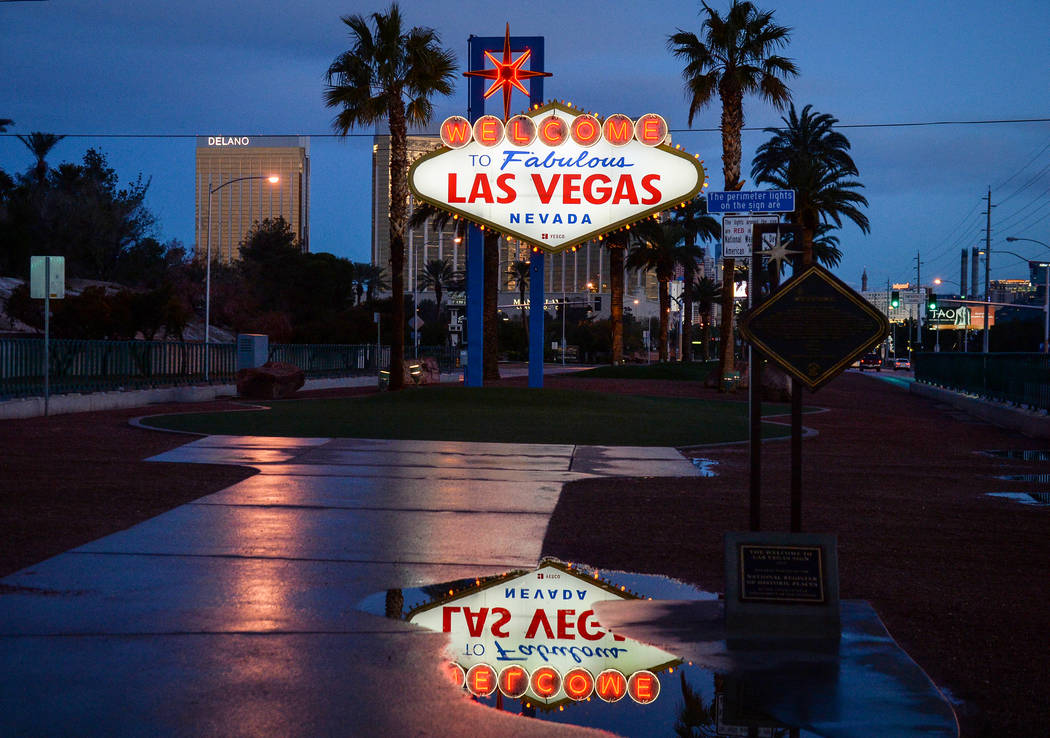 Rain puddles are left from snowfall the previous night at the Welcome to Fabulous Las Vegas Sign in Las Vegas, Monday, Feb. 18, 2019. (Caroline Brehman/Las Vegas Review-Journal) @carolinebrehman