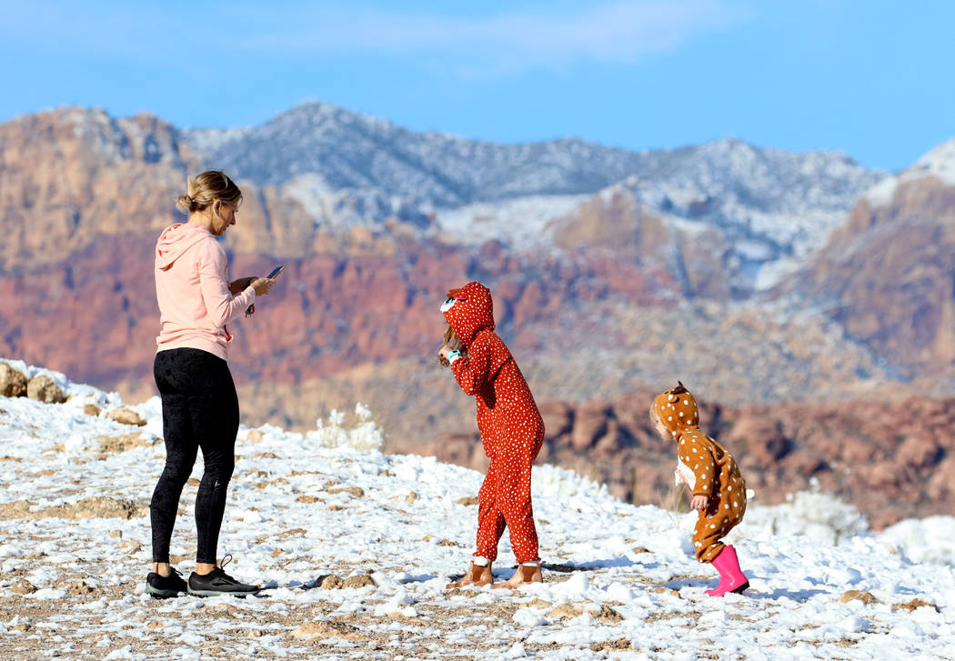Melissa Brewer takes a picture of her daughters Brooke, 6, center, and Charlotte, 2, at Red Rock on Monday, Feb. 18, 2019, in Las Vegas. (Bizuayehu Tesfaye/Las Vegas Review-Journal) @bizutesfaye