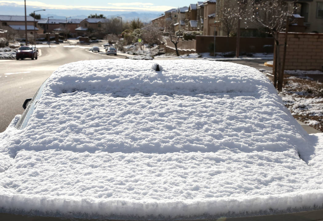 Snow covered car is seen in Summerlin on Monday, Feb. 18, 2019, in Las Vegas. (Bizuayehu Tesfaye/Las Vegas Review-Journal) @bizutesfaye