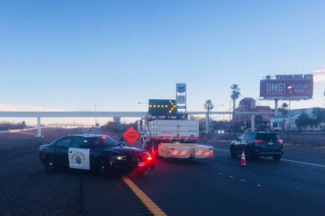 Nevada Highway Patrol blocks Interstate 15 at Primm at the California state line, which is closed due to icy roadway conditions, Monday, Feb. 18, 2019. (CHP Barstow/Twitter)