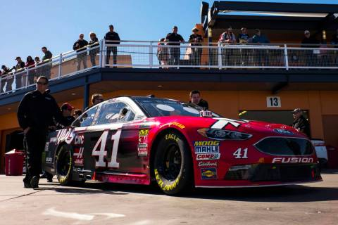 The car of driver Kurt Busch (41) goes through inspections before the Monster Energy NASCAR Cup Series Pennzoil 400 auto race at the Las Vegas Motor Speedway in Las Vegas on Sunday, March 4, 2018. ...