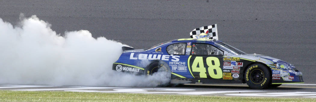 RJ FILE*** SPORTS - Jimmie Johnson burns out after winning the NASCAR Nextel Cup Series UAW-DaimlerCrystler 400 at Las Vegas Motor Speedway in Las Vegas Sunday, March 12, 2006. Johnson won the rac ...