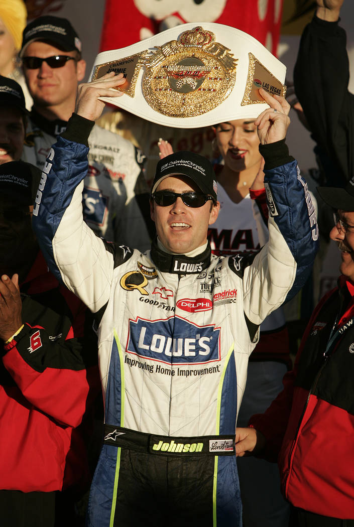 RJ FILE*** SPORTS - Jimmie Johnson celebrates with the trophy belt in winner's circle after winning the NASCAR Nextel Cup Series UAW-DaimlerChrysler 400 at Las Vegas Motor Speeway Sunday, March 12 ...