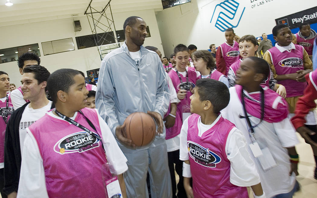 Los Angeles Lakers All-Star Kobe Bryant is surrounded by Lied Memorial Boys & Girls Club fans in Las Vegas on Friday, Feb. 16, 2007. Clint Karlsen/Las Vegas Review-Journal)