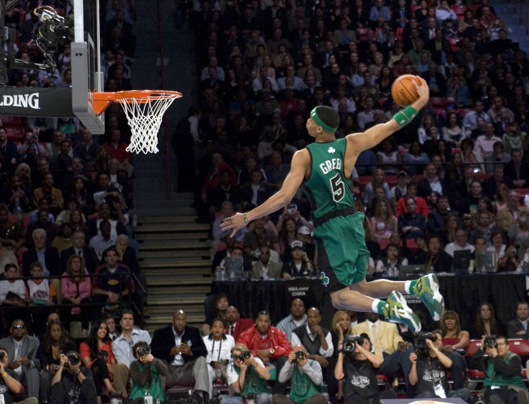 1aa689a88f7 Gerald Green of the Boston Celtics flies over a table on his final dunk to  win